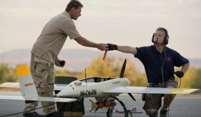 Raytheon Missile Systems engineers test a Cobra unmanned drone mounted with the new Pyros guided missile at Yuma Proving Ground. Pyros missiles are made for drones, just 22 inches long and weighing 12 pounds